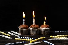 Chocolate cupcakes with candles.