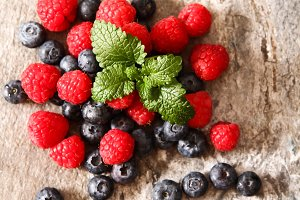 blueberries and raspberries on a gray stone background