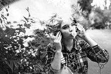 Hipster girl enjoying chewing gum