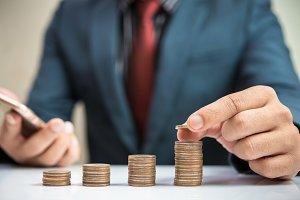 Businessman Hand Put Coins