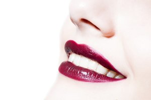 woman's dark red color lips