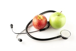 Healthy apples with stethoscope