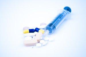 Syringe on blue