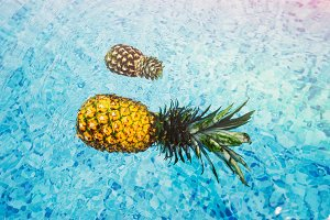 Pineapples Floating in the Pool