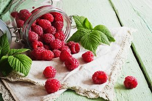 ripe raspberries in a glass jar