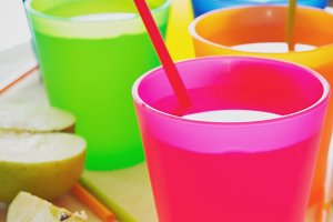 apple juice in colorful plastic cups