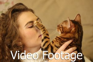 Bengal cat and girl having fun