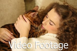 Girl stroking and kissing her cat