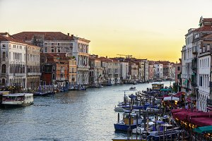 Canal with gondolas sunset scene, Venice, Italy.
