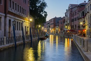 Evening canal scene at sunset, Venice, Italy.