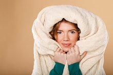 Girl wrapped in warm blanket