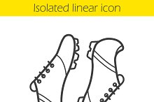 Soccer boots linear icon. Vector