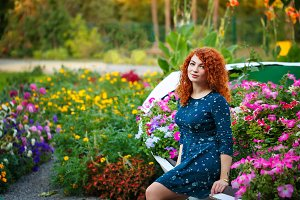 Red-haired girl in the park