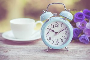 Retro clock with cup of coffee
