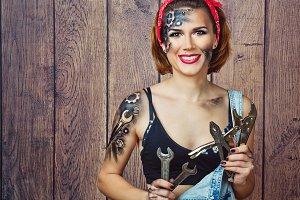 Girl mechanic selects tools