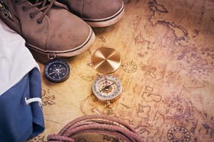 compass on map with accessory