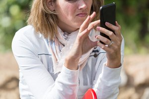 Adult woman using cell phone