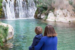 Family watching waterfall