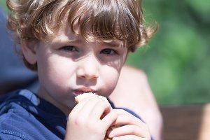 Cute little boy eating pancake