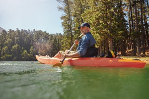 Mature man with kayak in a lake