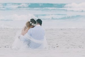 Happy wedding couple on the beach