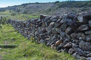 A dry stone wall made of random