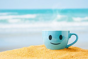 blue cup of coffee with happy face