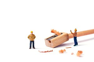 Miniature worker with pencil.