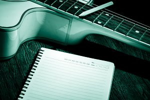Guitar and notebook