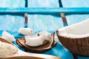 Open coconut on bright blue backgrou