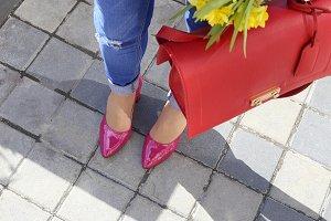Stylish woman with handbag