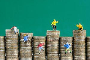Miniature climbers team climbing