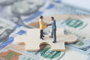 miniature businessman agreement