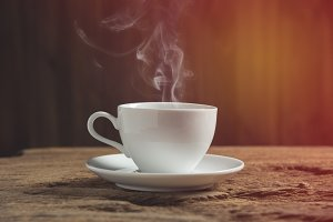 white coffee cup with smoke