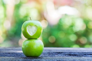 fresh green apple with heart shape