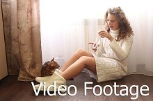 Girl plays with a Bengal cat.