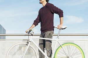 Young man with fixie bicycle.