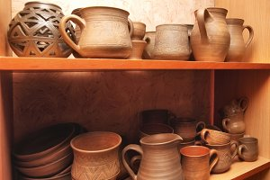 Old clay pots on the shelf