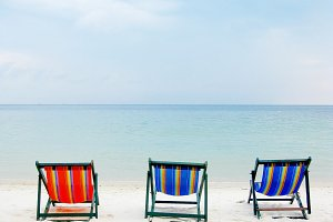 Deck chair on the beach for three