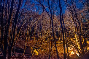 Tent illuminated with campfire