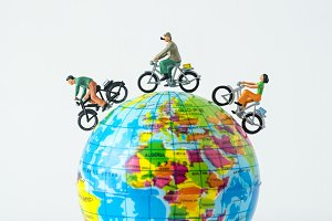 miniature people riding