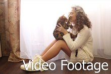 Girl play with Bengal cat on floor