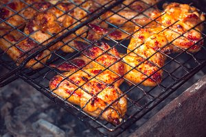 pieces of fried chicken on the grill barbecue