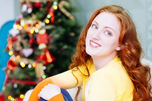 smiling beautiful woman in interior