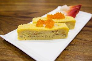 japanese egg sushi on white plate