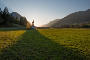 Church in the countryside at sunset