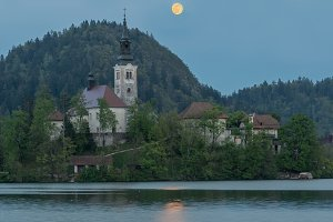 Bled church with full moon rising