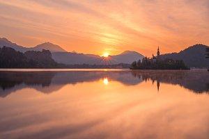 Vivid sunrise at lake Bled