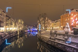 Festive and snowy Ljubljanica river.