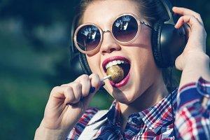 Girl listening to music. Lollipop